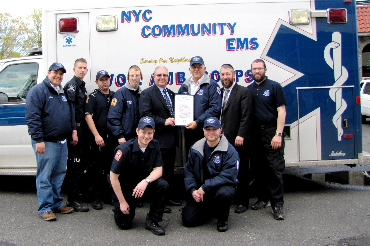 Assemblyman Steven Cymbrowitz (fourth from left) presents a citation to the members of the Midwood-based New York City Community EMS Volunteer Ambulance Corp. (CEMSVAC), commending them for their heroic actions during Superstorm Sandy.
