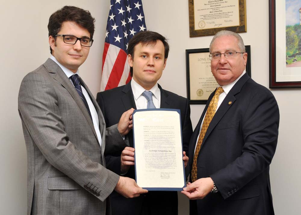 Assemblyman Steven Cymbrowitz presents a New York State Assembly citation to Suleyman Aydogan, Executive Director of the Turkish Cultural Center Brooklyn (left), and Saim Cagirici, Program Director of the Council of Turkic American Associations (center), on the occasion of Azerbaijan Independence Day.