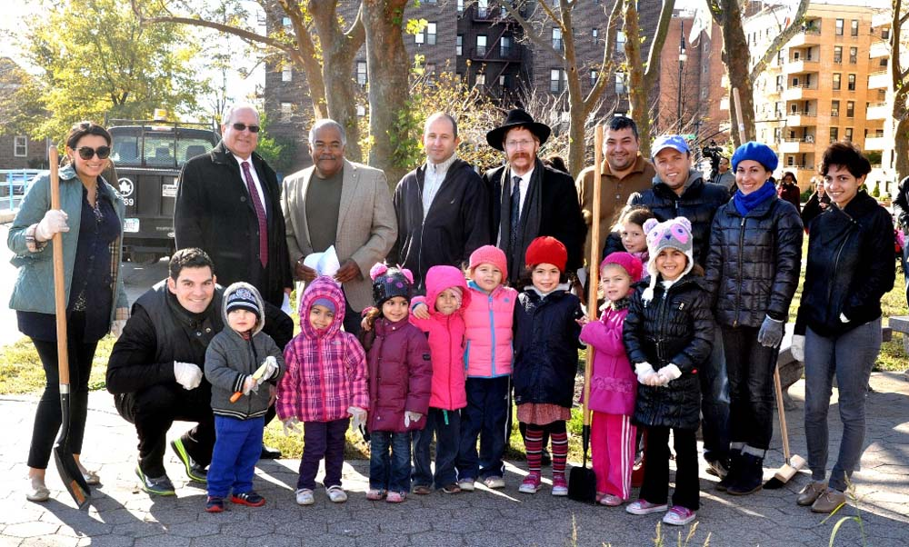 Assemblyman Steven Cymbrowitz with Brooklyn Parks Commissioner Kevin Jeffrey (standing, third from left), and student volunteers from the Mazel Day School. The students were displaced from their classrooms due to Superstorm Sandy and wanted to give back to their community by cleaning up Holocaust Memorial Park in Sheepshead Bay.