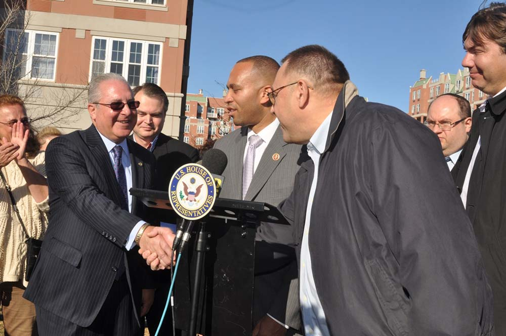 Assemblyman Steven Cymbrowitz greets a resident of the Oceana condominiums after a press conference on the Boardwalk with Rep. Hakeem Jeffries (center) calling on the Parks Department to abandon its plan to build a 20-foot-high comfort station in front of the condos.