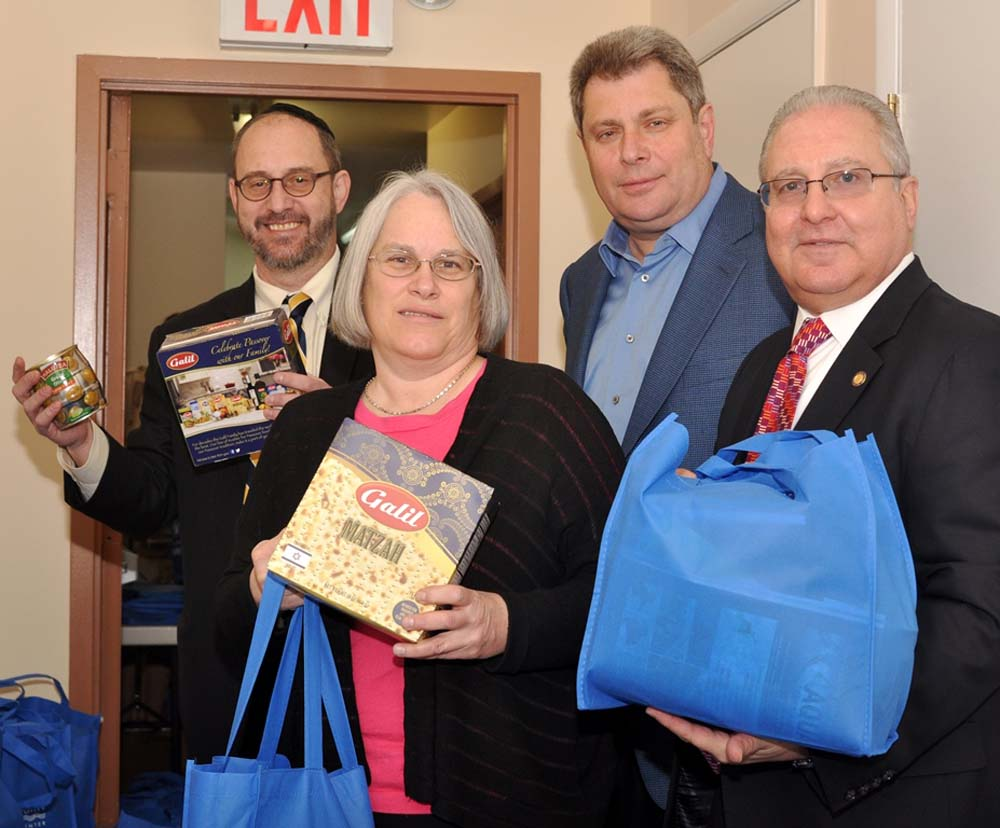Assemblyman Steven Cymbrowitz presented Passover care packages with his fellow partners in government (L-R): State Senator Simcha Felder, Assembly Member Helene Weinstein, and Assembly Member Alec Bro