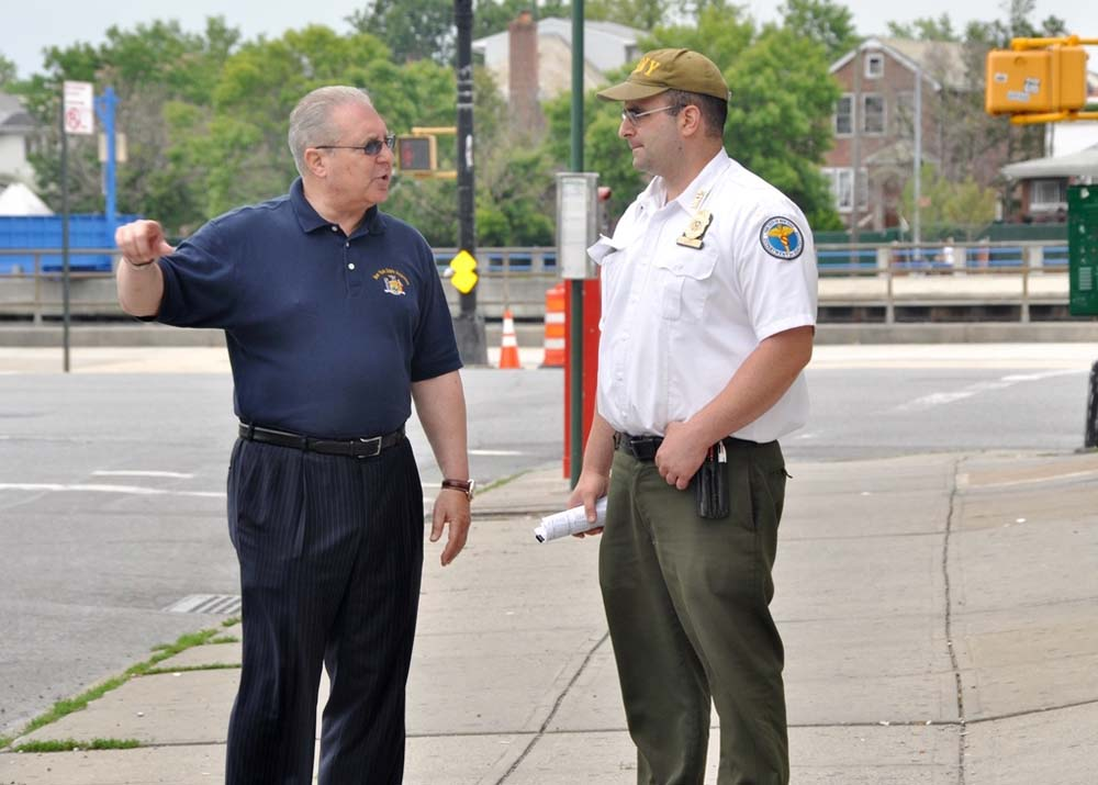Assemblyman Steven Cymbrowitz and Department of Sanitation Borough Superintendent Joe Lupo during a walkthrough of the neighborhood. Assemblyman Cymbrowitz discussed his concerns about trash in the neighborhood.