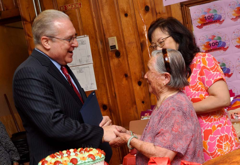 Assemblyman Steven Cymbrowitz wishes Homecrest Community Services member Xin Di Lei a happy 100th birthday.