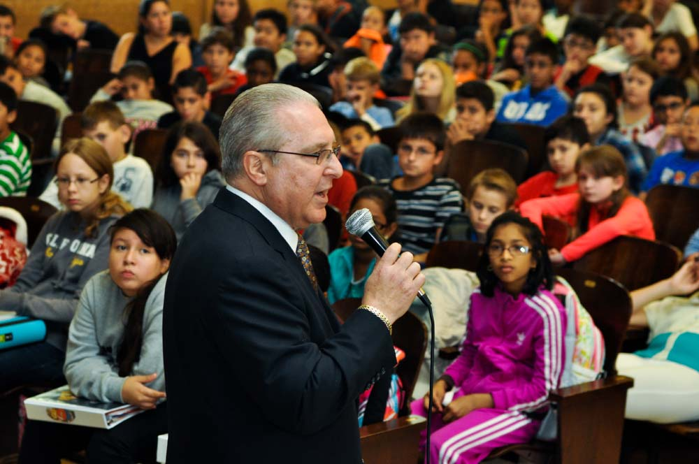 Assemblyman Steven Cymbrowitz talks to PS 209 students and presented the school with an iPad for winning first-place honors in his annual Holocaust Memorial Essay, Poetry, Performance and Art Contest.