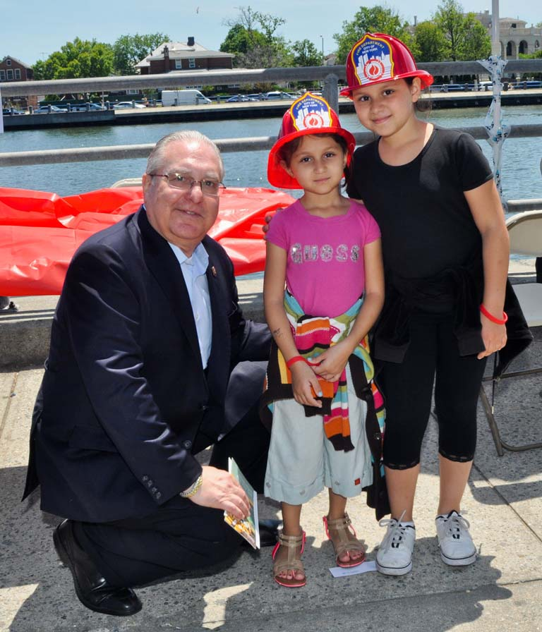 Two young ladies receive a lesson in fire prevention during Assemblyman Cymbrowitz' health fair.