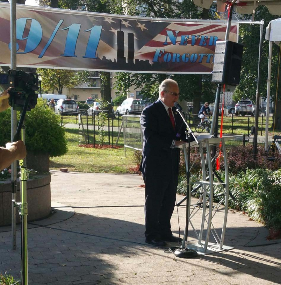 Assemblyman Cymbrowitz speaks at a September 11 commemoration in Asser Levy Park and joined many area residents in honoring the lives that were lost but never forgotten.