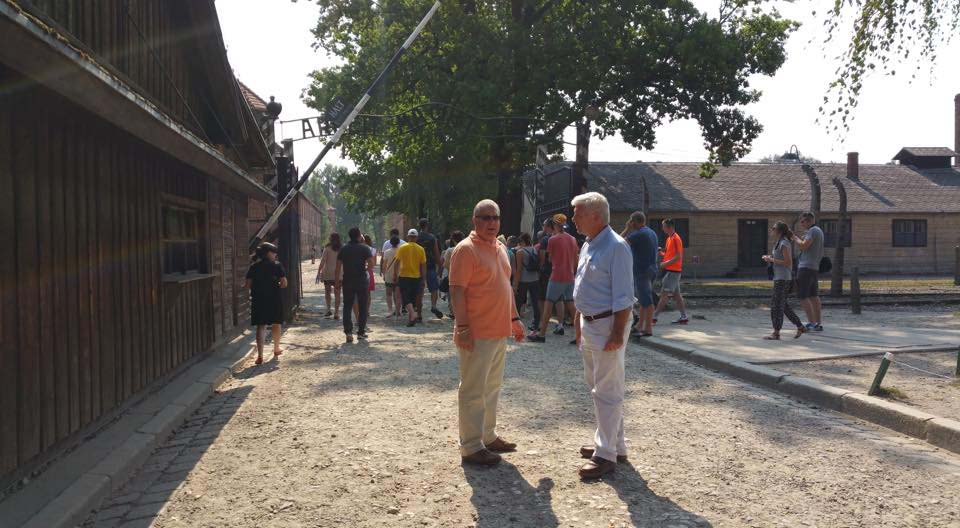 Assemblyman Cymbrowitz with his colleague, Assemblyman Kevin Cahill, at the main gate of Auschwitz to honor the six million Jews who perished during the Holocaust.