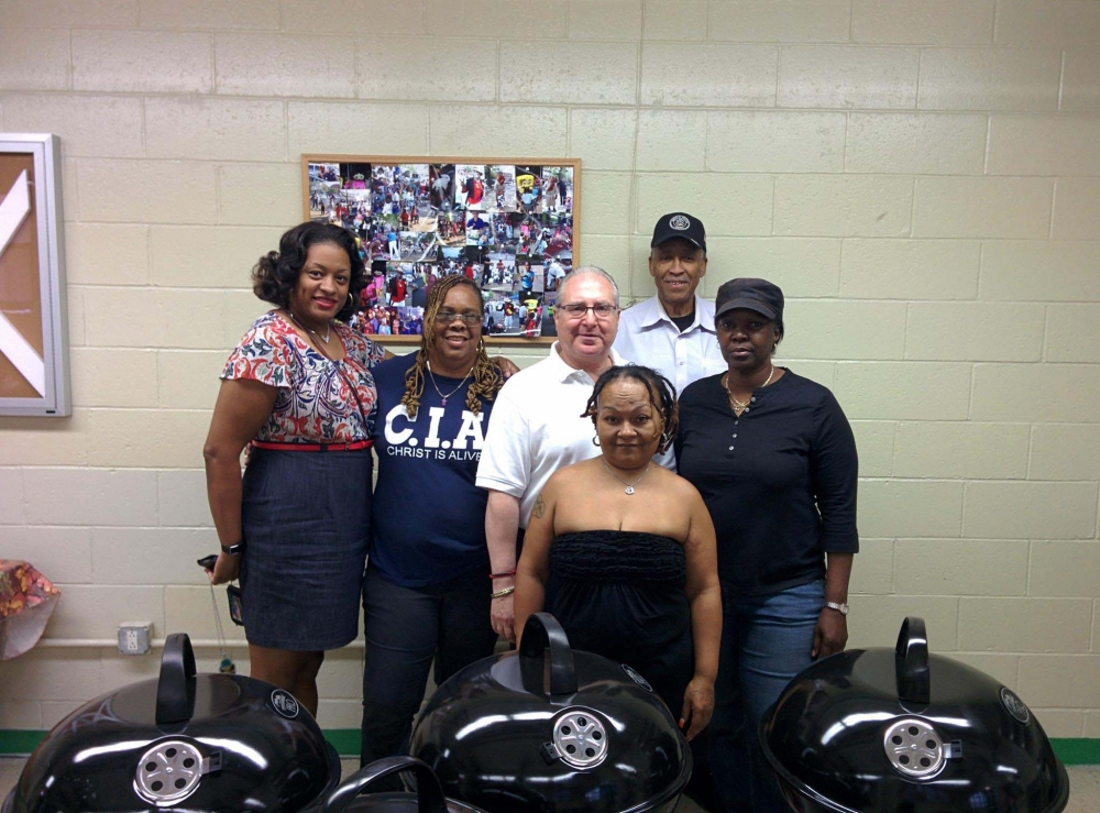 During a visit to Marlboro Houses, Assemblyman Cymbrowitz donated four barbecues, which tenants are free to borrow to indulge their own grilling magic. Surrounding the Assemblyman are (l. to r.) Samantha McMullin, property manager; Betty James, president of the Marlboro Tenants' Association, and Tenants' Association member Mary Rodriguez, vice president Sam Cooper and treasurer Gail Parnell.