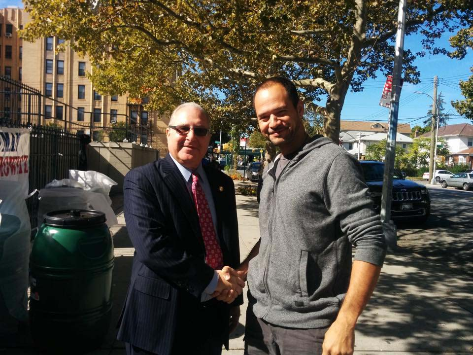 A constituent thanks Assemblyman Cymbrowitz during an event at Three Hierarchs Greek Orthodox Church where he distributed more than 150 rain barrels in partnership with the New York City Department of