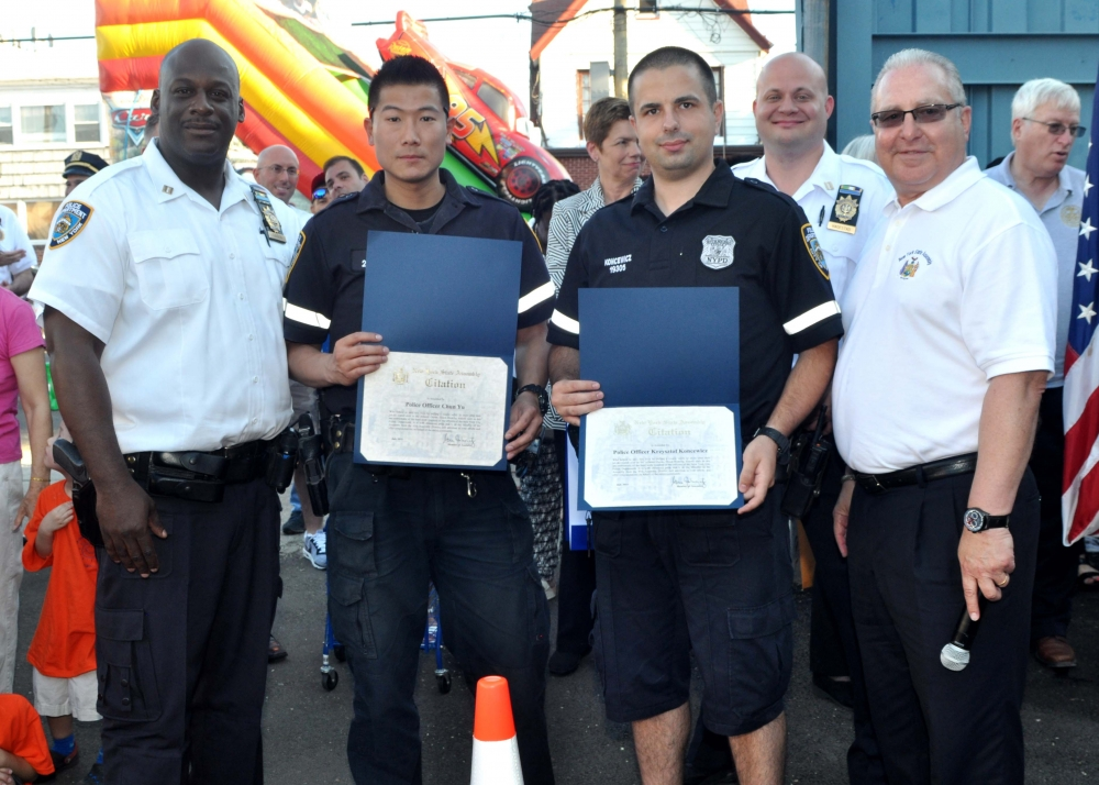 During this year's National Night Out Against Crime at the 61st Precinct, Assemblyman Cymbrowitz presented Assembly certificates to police officers Chun Yu (second from left) and Krzysztof Koncewicz (third from left), who helped to rescue a couple whose Jet Skis tipped over in the ocean off Manhattan Beach. From left are 61st Precinct Commanding Officer Winston Faison, Police Officer Yu, Police Officer Koncewicz, and Assemblyman Cymbrowitz.