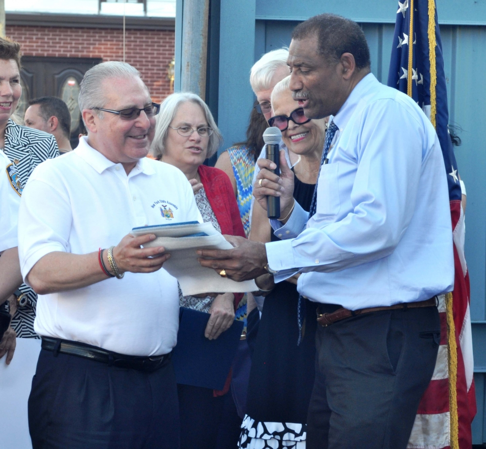 Yves Etienne, president of the 61st Precinct Community Council, presents Assemblyman Cymbrowitz with a plaque of recognition during the precinct's National Night Out Against Crime.