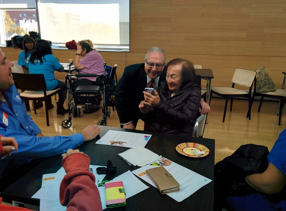Assemblyman Cymbrowitz takes a selfie with a constituent. The Assemblyman, Chairman of the Assembly's Aging Committee, joined representatives from AT&T at the Sephardic Community Center to teach seniors how to use their cell phones to post on social media and stay connected in this digital age as part of AT&T's Digital You program.