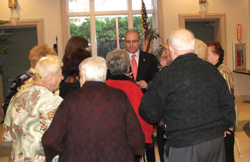 Assemblyman Cymbrowitz listening to the concerns of community residents while visiting a local senior center.