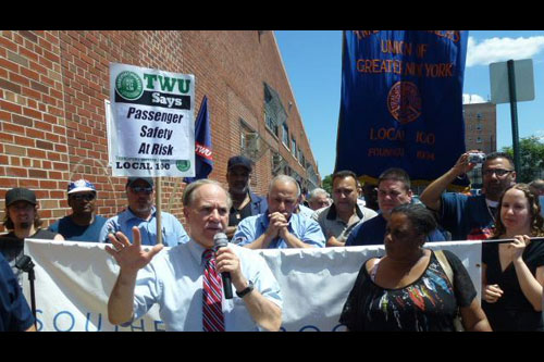 Assemblyman Colton is seen here leading a rally to restore the B64 bus.  He was joined by members of the community and TWU Local 100.