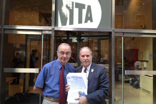 Assemblyman Colton is seen here with Bath Beach resident Mario D'Elia, delivering B64 petitions to an MTA Board meeting.