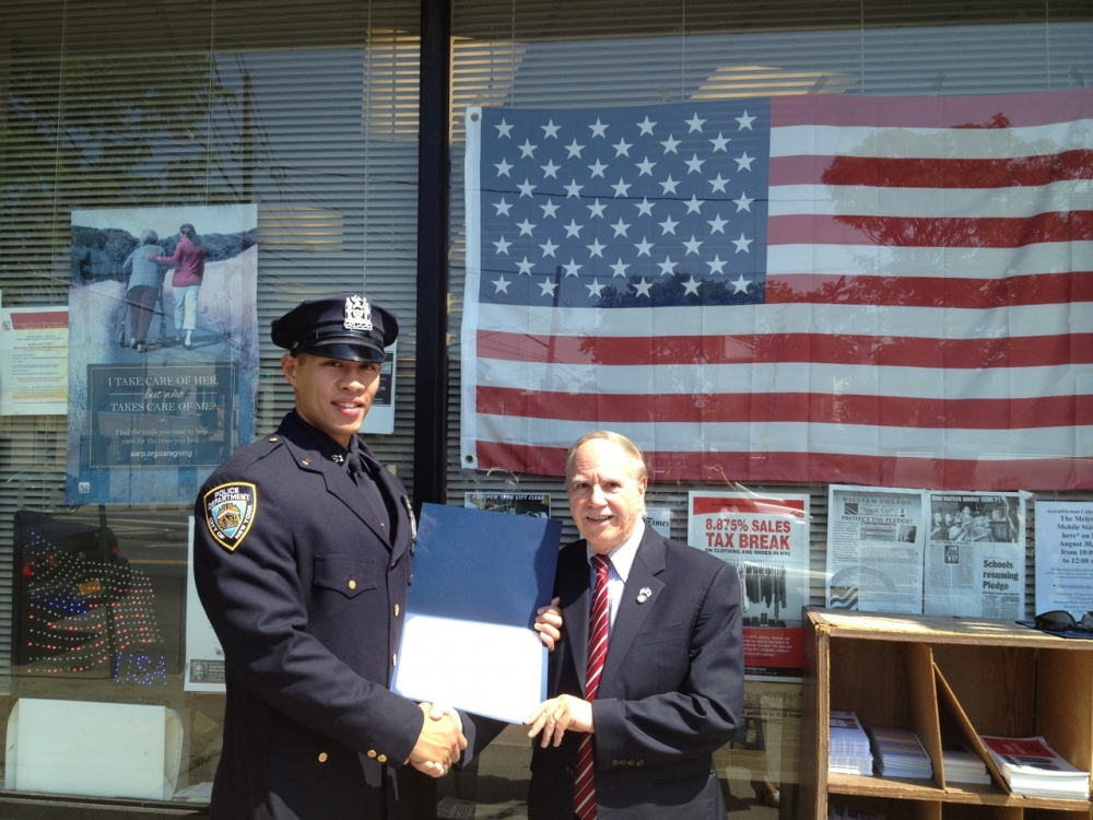 Assemblymember Colton recognizing police officer for outstanding service to protect the neighborhood.