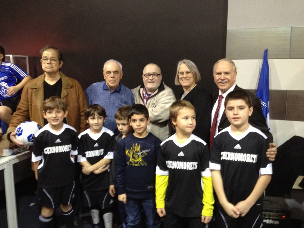 Assemblymembers Helene Weinstein and William Colton celebrate with Chermomorets youth soccer teams.