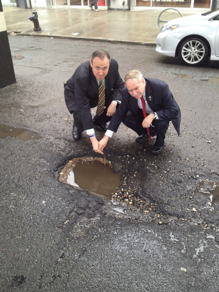 Assemblymember William Colton and Councilmember Mark Treyger documenting neighborhood pot holes to get the New York City Department of transportation to repave neighborhood streets.