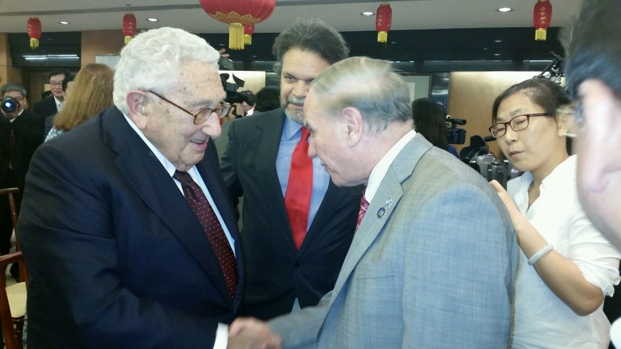 Assemblymembers William Colton and Felix Ortiz meeting with former Secretary of State Henry Kissinger.