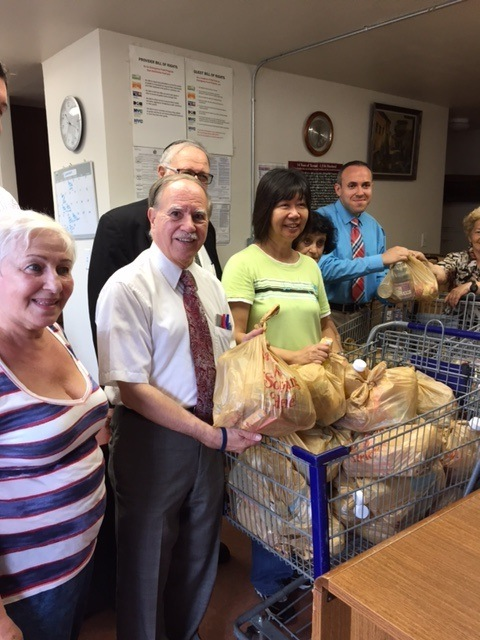 Assemblymember William Colton, Council Member Mark Treyger and Community Relations Director Nancy Tong helping with food giveaway at COJO of Bensonhurst.<br />&nbsp;