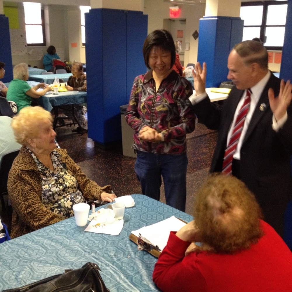 Assemblymember William Colton and community relations Director Nancy Tong with seniors at Marlboro Senior Center.