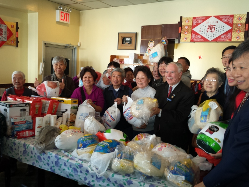 Assemblymember William Colton and Community Relations Director Nancy Tong with Homecrest Community Center Chair, Don Lee, at a turkey give away at the Homecrest Community Service Senior Center.