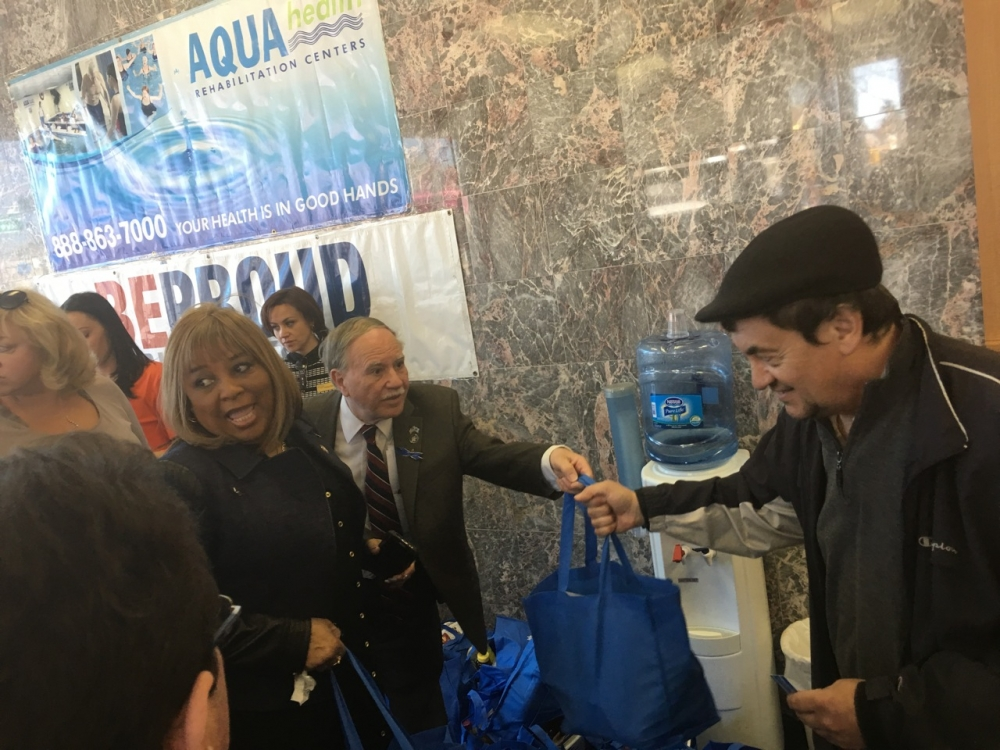 Assemblymembers William Colton and Pamela Harris at a Passover food giveaway sponsored by Be Proud Foundation.