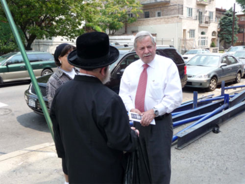 Assemblyman Abbate speaks with residents about the importance of a new Police Station house for the 66th Police Precinct.
