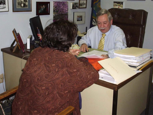 Assemblyman Abbate meets with a senior citizen in his office to discuss important matters affecting the elderly in the 