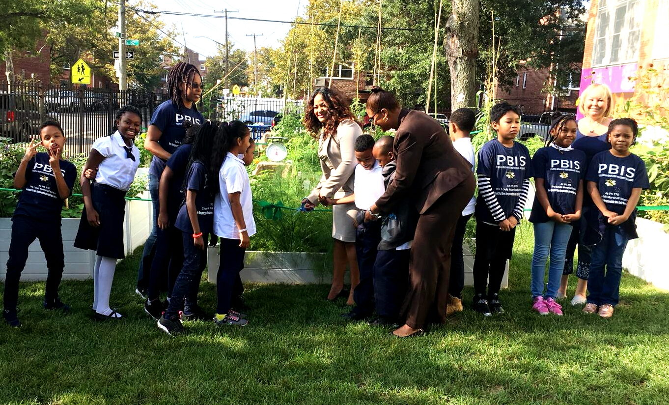 Teaching students of P.S 276 about gardening