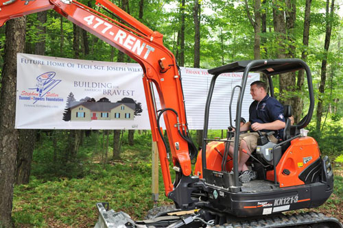 Joe looks over the property where his new home will be built. For more information on the Stephen Siller Tunnel to Towers Foundation, visit their Web site.