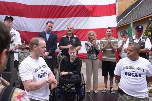 "Family and friends applaud the staff of the Stephen Siller Tunnel to Towers Foundation ""Building Homes for Heroes."""