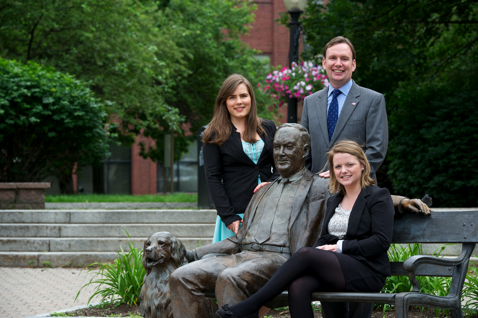 From l to r: Assemblyman Michael Cusick, Aoife Wilson (Clonakilty) and Lisa Keohane (Bantry) who were Whalen Interns from the University College Cork pictured at the Tricentennial Park in Albany. The park features a statue of former Albany Mayor Thomas Whalen and his dog - June 2013.