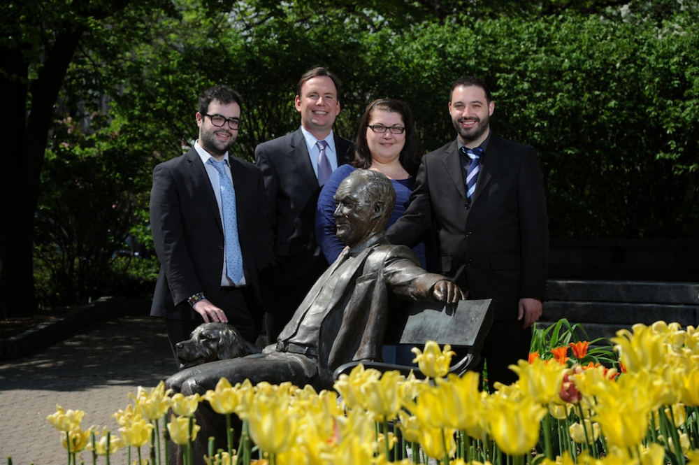 Assemblyman Michael Cusick is pictured with Brian Conmy, Leona Cantillon and Louis O'Keef who were Whalen Interns from the University College Cork. The photo was taken at the Tricentennial Park in Albany which features a statue of former Albany Mayor Thomas Whalen and his dog. Mayor Whalen was instrumental in creating the Whalen Intern program. – June 2014