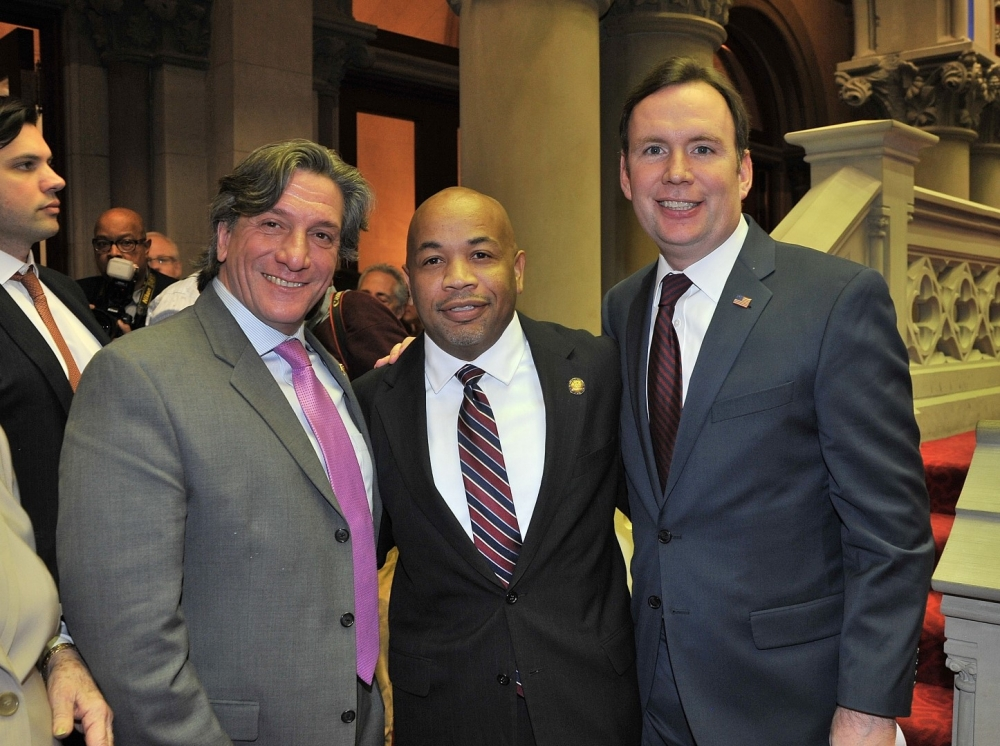 Assemblyman Matthew Titone and Assemblyman Michael Cusick join the newly elected Speaker of the New York State Assembly, Carl Heastie.