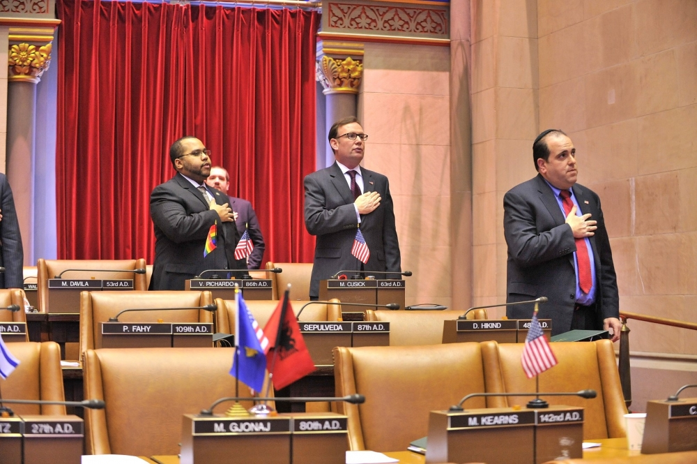The New York State Assembly opens each legislative session with the Pledge of Allegiance.