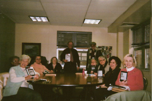 The folks at Stanley Isaacs book club receiving their new tablet readers that the Assemblyman and New York Public Library helped provide.