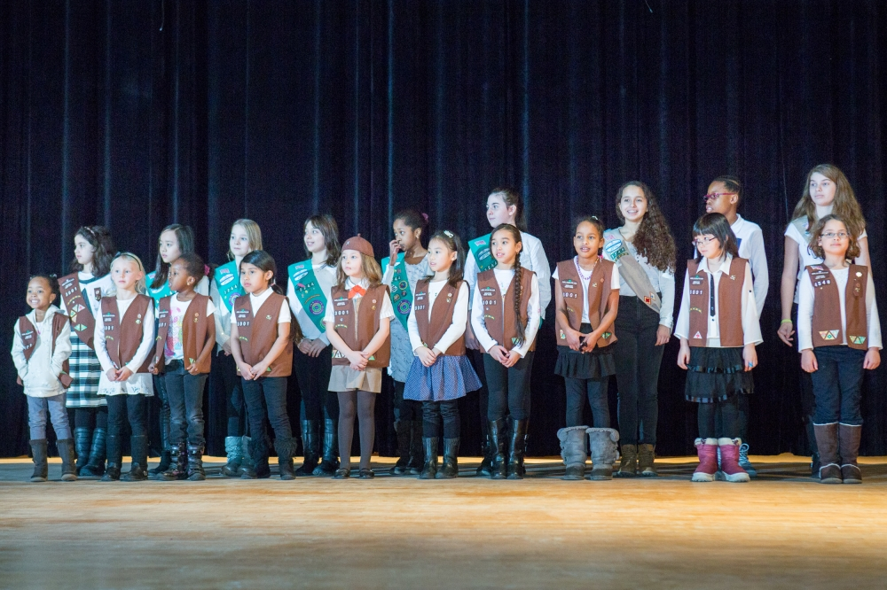 February 22—Julia Richman High School, UES— Roosevelt Island Girl Scout Troops 3001, 3244 and 3245 lead the crowd in the Pledge of Allegiance at the inauguration ceremony of Assembly Member Rebecca Seawright.