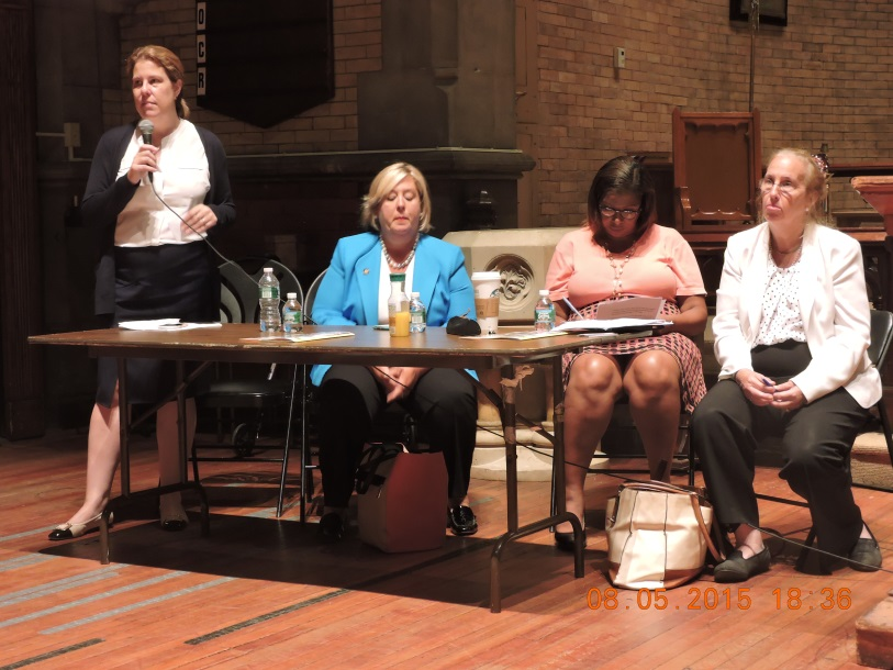 August 5, 2015— Chapel of the Good Shepherd, Roosevelt Island--- Assembly Member Seawright's counsel speaks on sub metering at a Roosevelt Island town hall.