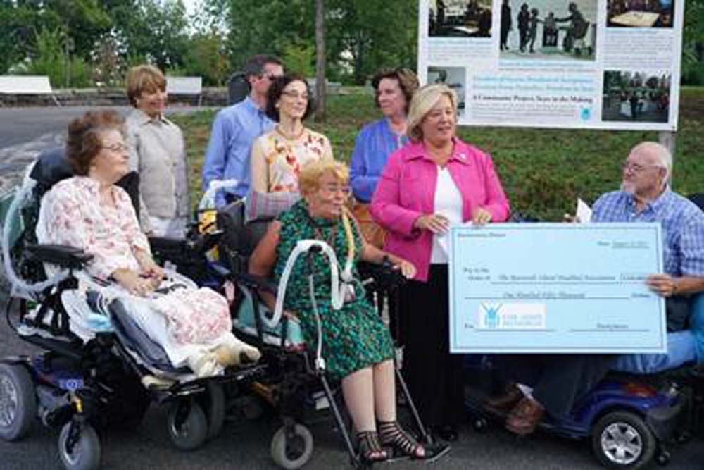 "August 12, 2015---Southpoint Park, Roosevelt Island--- Assembly Member Seawright presents a $150,000 check to Jim Bates of the Roosevelt Island Disabled Association. The Roosevelt Island Disabled Association has been instrumental in the planning and fundraising for the completion of the FDR Hope Memorial. Unfortunately, due to lack of funding, the project has been held up since 2009. The plight of the association to furnish additional funds was published in the local media and seen by a charitable individual. The charitable individual, who asked to remain anonymous, worked with Assembly Member Seawright and the Roosevelt Island Disabled Association to bring this project closer to completion. Thanks to the anonymous donor and Seawright, the group is finally able to commission the artist to sculpt Franklin Delano Roosevelt sitting in a wheelchair, extending his hand to a young girl walking with crutches and leg braces. <a href=""https://www.dnainfo.com/new-york/20150812/roosevelt-island/anonymous-donor-gives-150k-complete-fdr-hope-memorial"" target=""blank"">http://dnain.fo/1HH0LjB</a>"