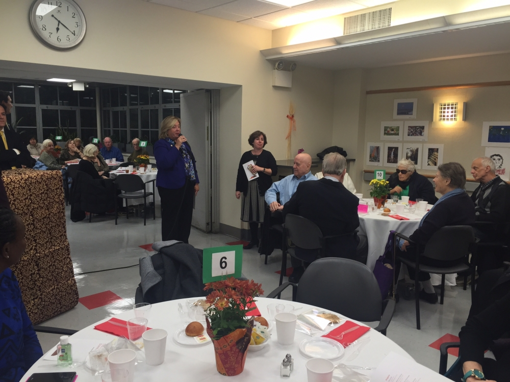 November 23, 2015---Lenox Hill Neighborhood House, Upper East Side---Assembly Member Rebecca A. Seawright speaks to seniors at Lenox Hill Neighborhood House's Annual Thanksgiving Dinner Dance.