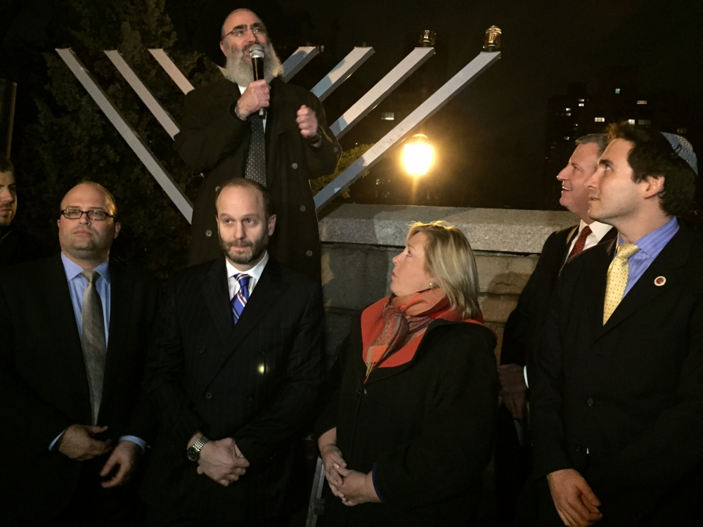 December 7, 2015--- Carl Schurz Park, NYC--- Assembly Member Rebecca A. Seawright stands in support of the relighting of the Menorah in Carl Schurz Park after it was knocked down on the first night of Hanukkah.