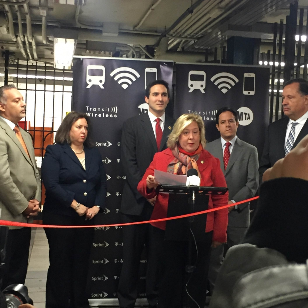 December 8, 2015---86th Street Uptown Lexington Line ---Assembly Member Rebecca A. Seawright stands with Council Member Ben Kallos in support of Transit Wireless Wifi.