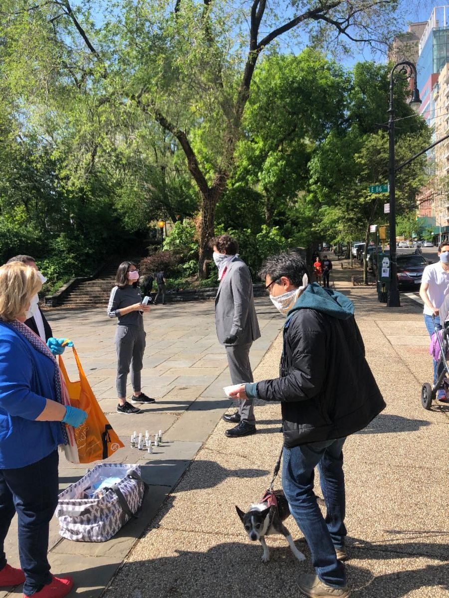 Assembly Members Rebecca Seawright and Dan Quart, and Council Member Ben Kallos greeting morning park visitors with face masks and hand sanitizers.