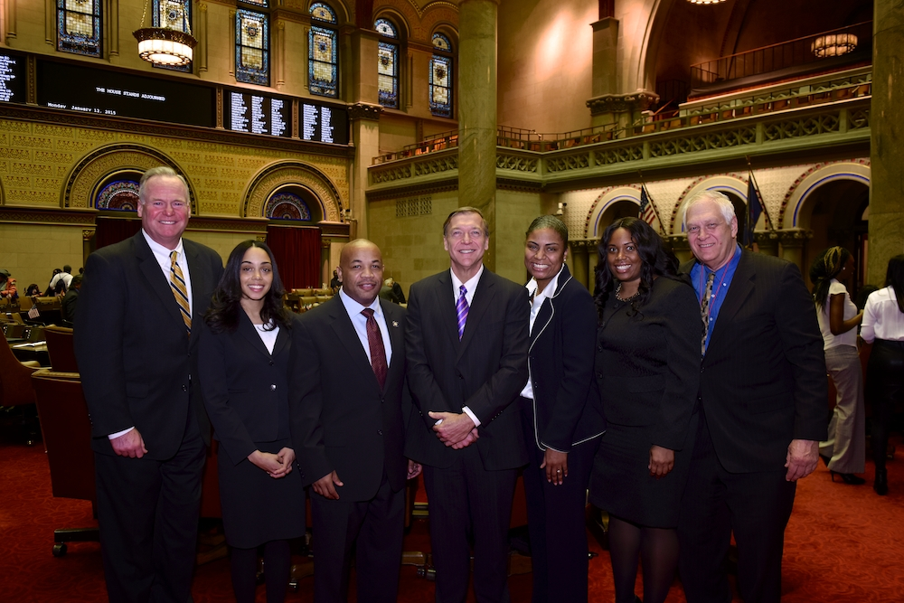 Assembly Member Latoya Joyner with Assembly Speaker Carl E. Heastie and other colleagues.