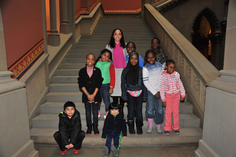 Assembly Member Latoya Joyner and local children.