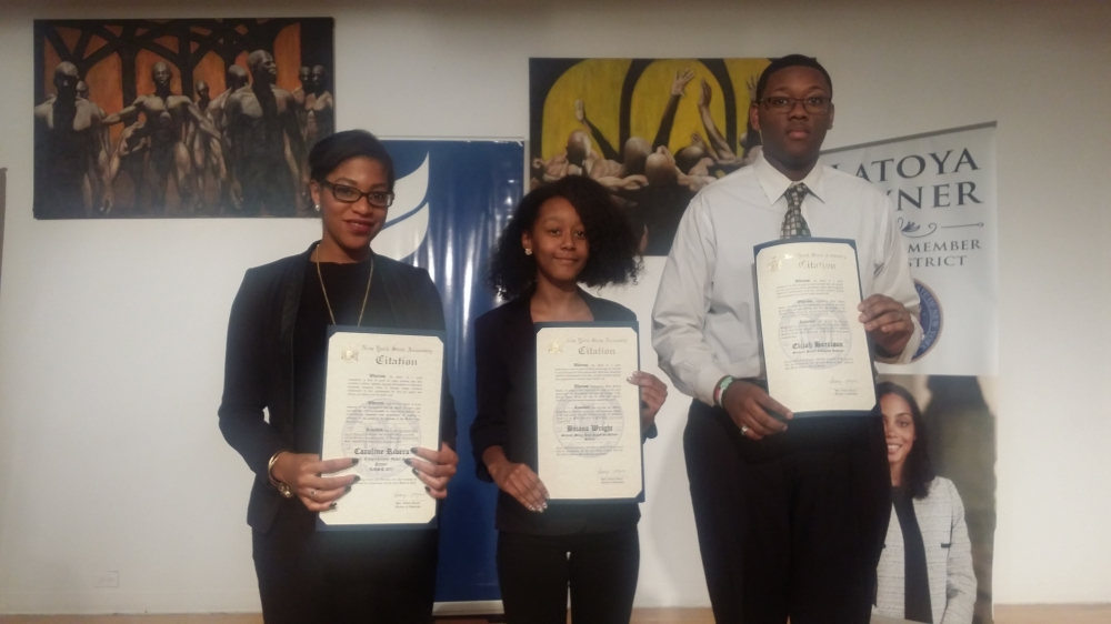 For Black History Month 2015, Assemblywoman Latoya Joyner honored District 9 high school students and teacher Caroline Rivera (L), from the Comprehensive Model School Project.