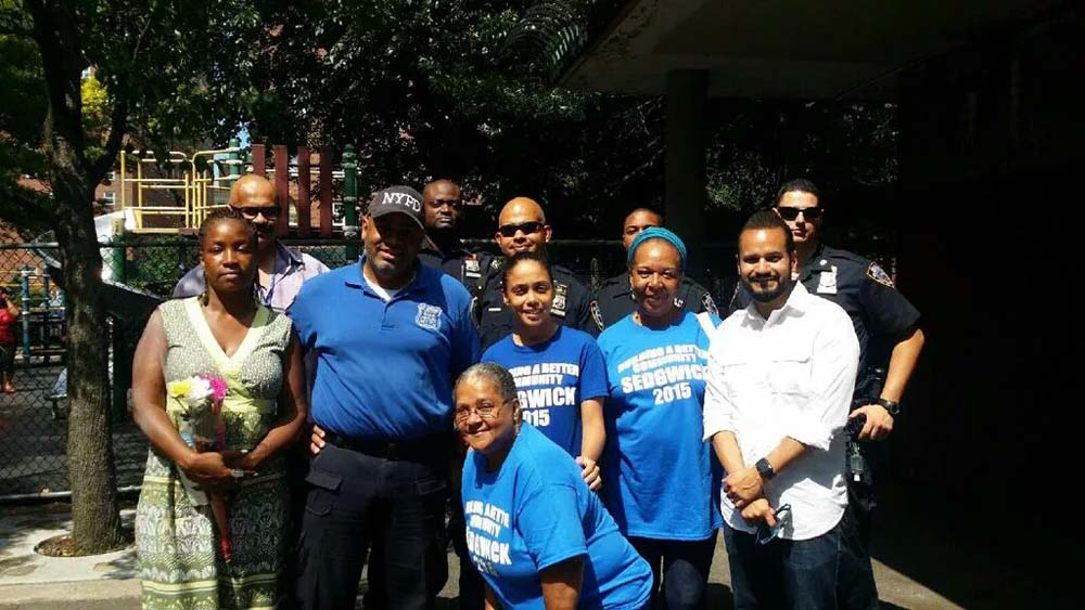 Assemblywoman Latoya Joyner enjoys Sedgwick Houses' Family Day with community.