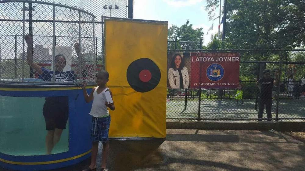 "Focusing on supporting the long standing tradition of Family Day at Sedgwick Houses, Assemblywoman Latoya Joyner sacrificed herself by participating in her first ever ""Dunk the Assemblywoman"" event."