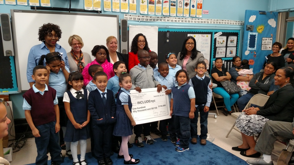 Assemblywoman Latoya Joyner presents a ceremonial check to New York City-based organization INCLUDEnyc. The additional aid she secured ($150,000) will be directed to INCLUDEnyc to establish beneficial programming and services for P.S. 035 Franz Siegel's special needs population.